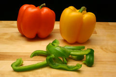 Bell Peppers. On Cutting Board Royalty Free Stock Image