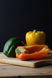 Bell Peppers Arrangement on Wooden Board Royalty Free Stock Image