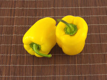 Bell peppers on brown wicker straw mat close up Royalty Free Stock Photography