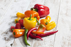 Bell peppers, chili and habaneros on white wood Stock Image