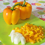 Bell peppers on a chopping board Royalty Free Stock Photos