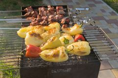 Bell peppers cooked outdoor with pieces of pork meat Royalty Free Stock Photography