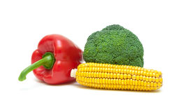 Bell peppers, corn and broccoli isolated on white background Stock Photo