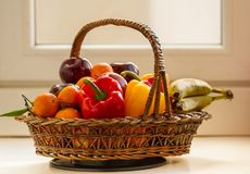 Wicker basket full of seasonal fruits and vegetables stock photos