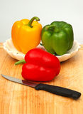 Bell Peppers On Chopping Board Stock Image