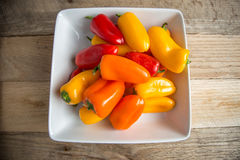 Bell peppers in a rectangular dish on a weathered wood backgroun Stock Photography