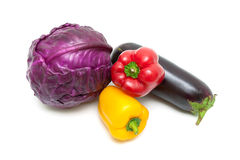 Bell peppers, red cabbage and eggplant isolated on white backgro Stock Photos
