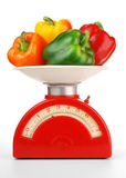Bell peppers on scale Stock Images