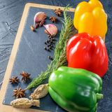 Colorful bell peppers for cooking on the board. royalty free stock images