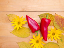 Bell peppers, topinambour flowers and autumn leaves Stock Photo
