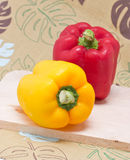 Bell Peppers On A Wooden Cutting Board. Stock Photo