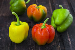 Bell peppers on wooden table Stock Photos