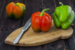 Bell peppers on wooden table Royalty Free Stock Photos