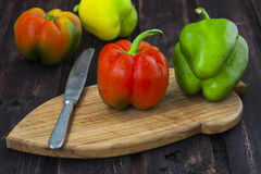 Bell peppers on wooden table Royalty Free Stock Photography