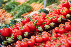 Bell peppers and zucchinis on farmers market in Paris, France Royalty Free Stock Images