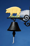 Bell with piglet Stock Image