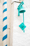 Bell and pole. Turquoise painted bell in Portmeirion village Stock Photos