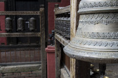 Bell and prayer wheels in nepal Stock Photography