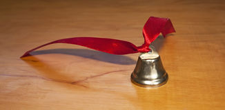 Bell with red ribbon Stock Image