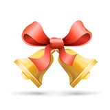 Bell and ribbon. Two handbells tied a red ribbon on the white background Stock Photo