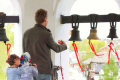 The bell ringer ringing the church bells. Royalty Free Stock Image