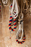 Bell Ringing. Ropes used for bell ringing hanging on a church wall Royalty Free Stock Image