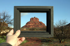 Bell Rock Framed. Bell Rock in Sedona Arizona is framed in a black wooden picture frame and held by me the photographer royalty free stock photography
