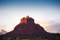 Bell Rock Sedona. Beautiful Bell Rock located in Sedona Arizona at sunset with just enough light from the sun to light up the top with blue skies and clouds in royalty free stock photos