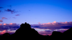 Bell Rock of Sedona at Blue Sunset. Beautiful Bell Rock in silhouette as the sun goes down in the town of Sedona. The Sky is lit up in Blue and Pink stock photos