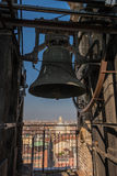 The bell and the roofs in Turin, Italy. The bell of the bell tower of the Cathedral of Turin and the view of roofs Royalty Free Stock Photo