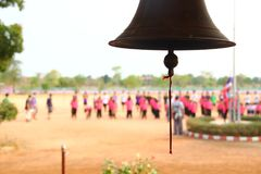 Bell in rural schools in Thailand. Line up the morning flag Stock Photos