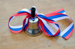 Bell in the Russian school on 1 September Royalty Free Stock Image
