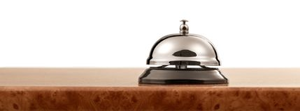 Vintage service bell at hotel reception - vintage. Bell service object reflection business counter metal Stock Photography