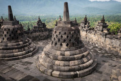 Bell shaped stonework. View from the top of Borobudur temple, Indonesia Stock Photo