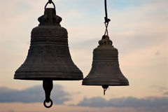 Bell silhouette. Dark silhouette sunset sky bells Royalty Free Stock Images