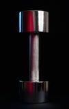 Bell sourde-muette de métaux lourds sur le fond noir Photographie stock