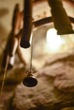 Bell on a string on a bamboo hand-made lamp Stock Images