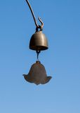 The bell in the temple. The bell hang on the tree that grow in temple area Royalty Free Stock Photography