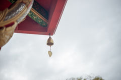 Bell in the temple. Small gold color of buddhist bell in the temple Stock Image