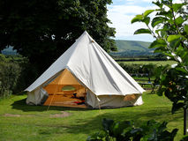 Bell tent. Traditional canvas bell tent in english countryside stock photo
