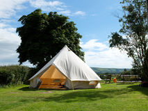 Bell tent. Traditional canvas bell tent in english countryside royalty free stock image