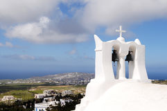 Bell Tower. A historic whitewash bell tower face to aegean sea Stock Photo