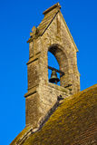 Bell tower. A single bell in an open church tower against blue sky Royalty Free Stock Photo