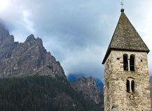 The bell tower. Scenic bell tower close to the dolomite rocks in Italy Stock Photography