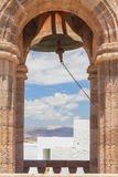 Bell tower with ancient bell. Lindos town Royalty Free Stock Photography