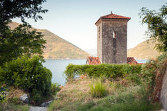 Bell tower of ancient Orthodox Church. Perast Royalty Free Stock Photos