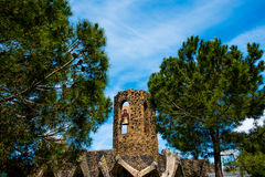 Bell tower of antoni gaudi colonia guell church in catalonia in sunny day. Ancient bell tower in catalonia with clear blue sky royalty free stock images