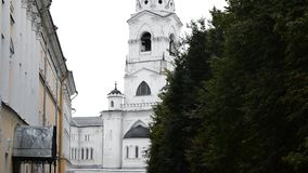 The bell tower of the Assumption Cathedral, Ringing bells - 11 hour service. Chime. stock video