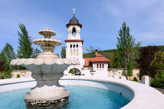 Bell tower and basin at orthodox Curchi monastery Royalty Free Stock Photo