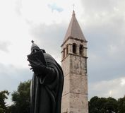 Bell tower behind the statue of Gregory of Nin Royalty Free Stock Image